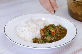 step 7: Serve with rice, garnish with fresh coriander.