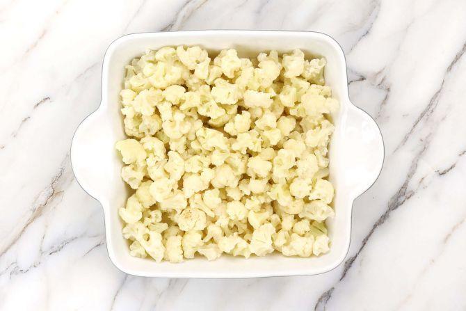 Add the cauliflower to the baking dish