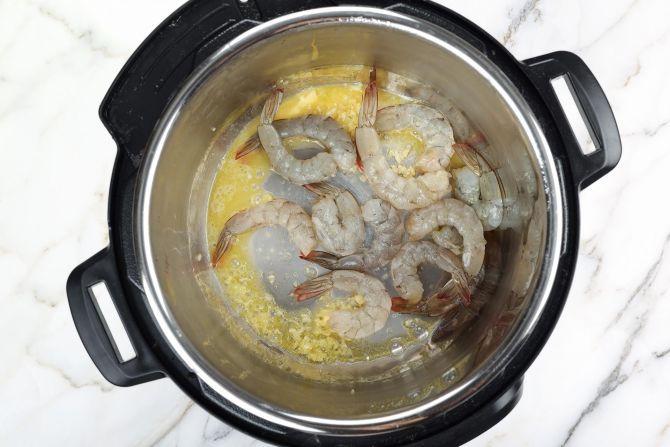 Sauté the garlic and sear the shrimp