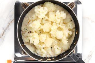 Add the par-boiled cauliflower.
