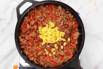 step 4: Add corn and de-glaze the pan