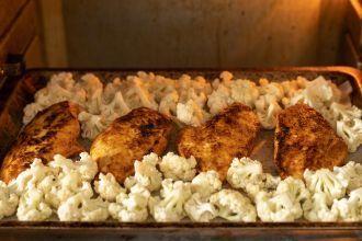 Step 5: Bake the chicken with cauliflower.