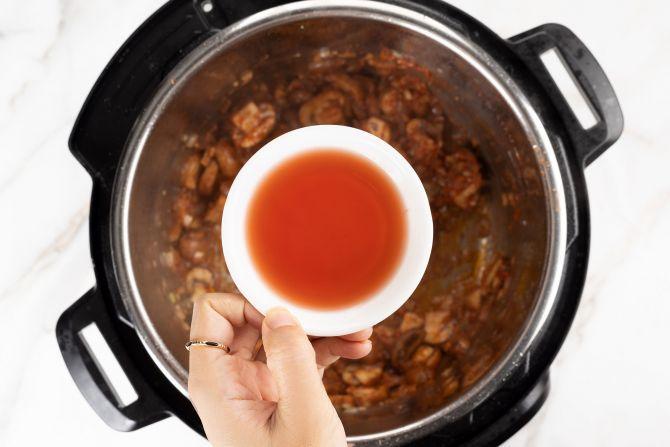 step 3: Stir in tomato paste and deglaze with red wine vinegar